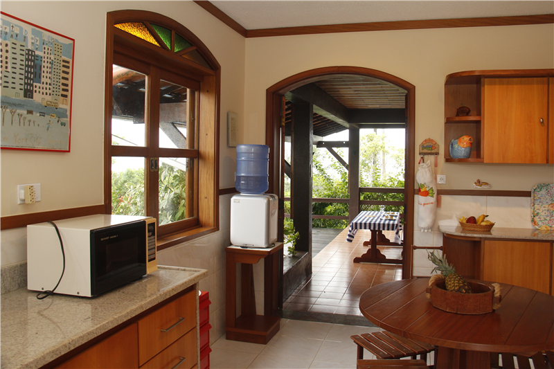 Kitchen with access to veranda & swimming-pool