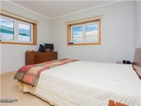 Bedroom with the en-suite bathroom and a walk-in wardrobe.