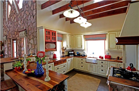 Kitchen with hard wood surfaces