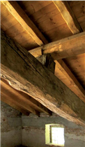 Detail of the new roof built preserving the original timber structure