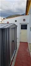 Left side of villa with 2 sheds (1 brick built)
