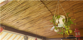 Pergola with feature cane ceiling.