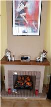 Feature brick fireplace.