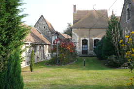 main entrance property with outbuilding on the street site on the left