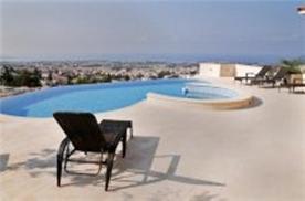 The beautiful limestone terrace around the pool