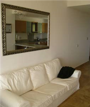 Huge Cypriot mirror and sofa.