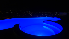 The jacuzzi and pool at night.