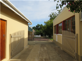 Easy access to back of property with a carport behind the garage