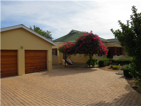 Spacious double garage with extra secure parking