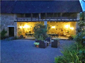 The covered terrace lit at night