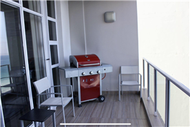 Quick Gas BBQ with high end floor tiling.