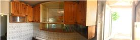 Kitchen. Wooden cabinets.
