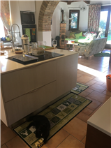 kitchen island through arch to living