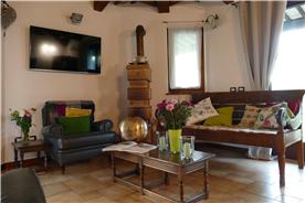 livingroom and antique terracotta woodstove
