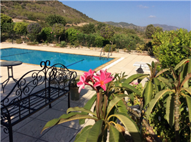 VIEW OF THE POOL AND MOUNTAINS