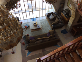 View of sitting room from mezzanine balcony