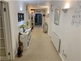 Hallway leading to rooms 7 - 10 & massage treatment room