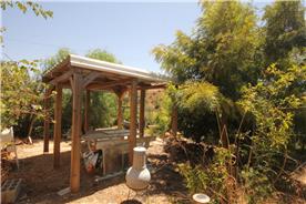 Shade canopy eating area near house