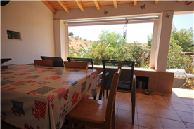 Terraced entry to property with dining & sitting area, which can be enclosed with roll down blinds.