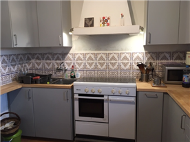 Modern kitchen work area with traditional tiling
