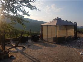 new gazebo and hot tub on lower terrace.