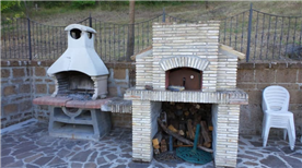 BBQ and Pizza Oven on second terrace.