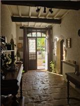 Front door & hallway with original flagstones