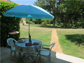 Patio in front of the 2nd small gîte overlooking gardens & pool
