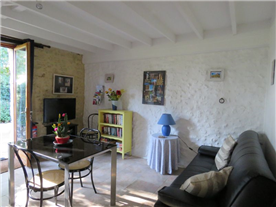 Living-area in small gîte  leading to a bedroom & ensuite