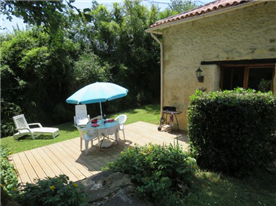Wooden decking for private terrace & garden in front of one of the 2 small gîtes