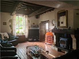 Triple aspect living-room with wood burner