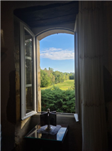 View of the countryside from 1 of the 3 windows of the living-room