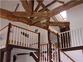 In the spacious gîte, lattice beams and mezzanine leading to bedroom  & bathroom 2