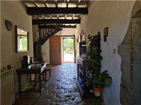 Hallway with back door leading to a ...