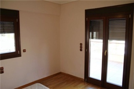 5th floor guest bedroom with electronic door and window shutters available throughout each level