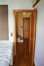 5th floor guest bedroom hallway leading via the marble staircase to the 6th floor studio apartment