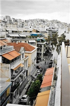 Spectacular views of Athens and city surrounds from Studio apartment verandah