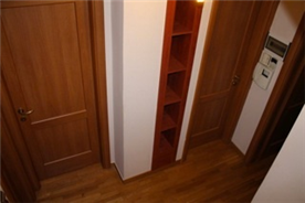 5th floor hallway with built-in shelving also including a video-intercom system