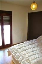 5th floor guest bedroom with opening doors to balcony
