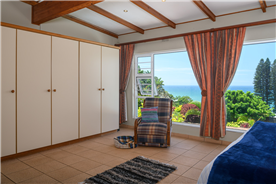 Master Bedroom with Built in Cupboards and Sea Views to East