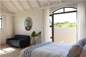 Guest Bedroom 2. Views of the ocean in the distance,