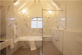 Main Bathroom with Spa bath and spacious walk in shower