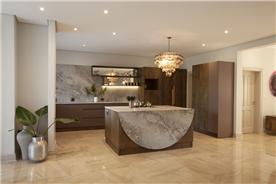 Gorgeous designer kitchen with Caesarstone countertops and bespoke lighting.