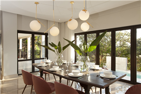 Exquisite dining area with custom bulkhead and lighting design, views to the pool and golf course