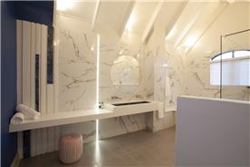 Main Bathroom custom marble wall designs with unique custom designed indigo granite basin