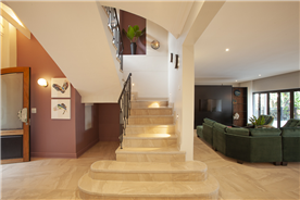 Spacious Staircase leading up to the main bedroom and guest bedroom