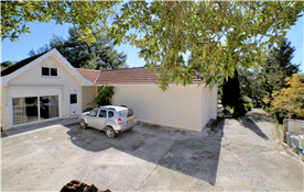 Yard/Parking area by entrance to  house & driveway  down to gate