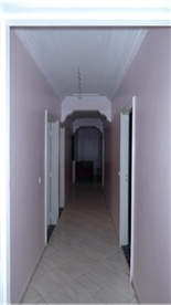 Long, marble lined corridor within appartment.