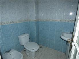 Bathroom 1. Contains bath, shower attachment , sink and bidet.