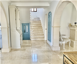 Lobby leading to guest bathroom/staircase/dining and living rooms